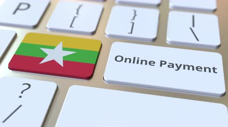 финансовый : Online Payment text and flag of Myanmar on the keyboard. Modern finance related conceptual 3D animation