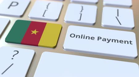 účty : Online Payment text and flag of Cameroon on the keyboard. Modern finance related conceptual 3D animation