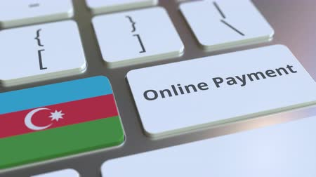 финансовый : Online Payment text and flag of Azerbaijan on the keyboard. Modern finance related conceptual 3D animation Стоковые видеозаписи