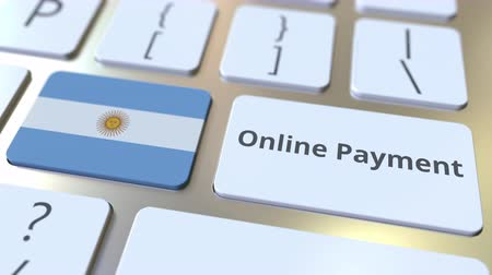 цифровой : Online Payment text and flag of Argentina on the keyboard. Modern finance related conceptual 3D animation Стоковые видеозаписи