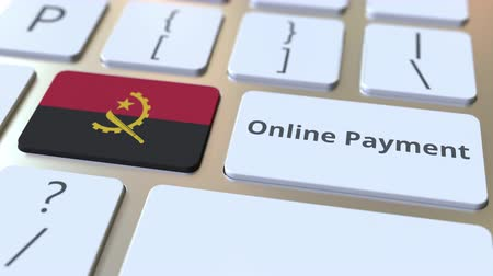 düğmeler : Online Payment text and flag of Angola on the keyboard. Modern finance related conceptual 3D animation