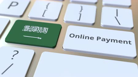 ulusal bayrağı : Online Payment text and flag of Saudi Arabia on the keyboard. Modern finance related conceptual 3D animation