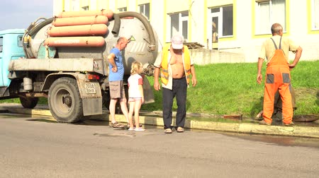 septic : sewerage worker on street cleaning pipe, sewerage repair diver Lutsk Ukraine 08012018