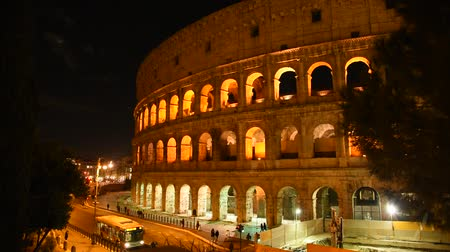 Glimpse of the Colosseum at night, in Rome illuminated by artificial light