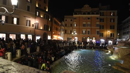 Trevi Fountain surrounded by tourists, evening shooting in Rome
