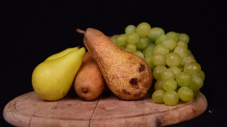 Seasonal fruit still life in studio in black Background Stock mozgókép