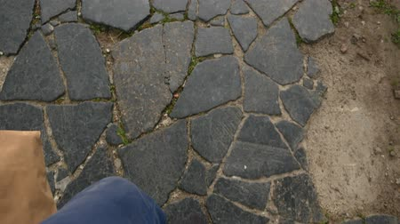 kayış : In sneakers, paving stones top view sanny day