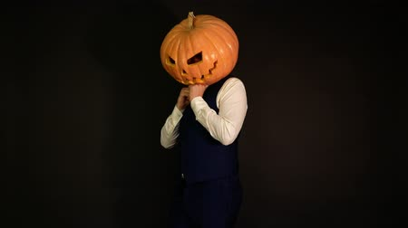 oco : pumpkin-headed man shy but finds strength.carved pumpkin. Concept halloween.