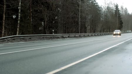 autó : Cars moving along a freeway, in Latvia.