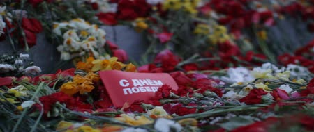 war : Victory Day, a non-working holiday, that commemorates the capitulation of Nazi Germany to the Soviet Union during the Second World War. Flowers placed at a monument, in Latvia.
