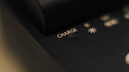 recharging : Battery charger LED indicator light, blinking.