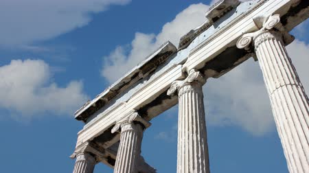greek culture : The Acropolis of Athens is an ancient citadel located on a high rocky outcrop above the city of Athens and containing the remains of several ancient buildings of great architectural and historic significance, the most famous being the Parthenon Stock Footage