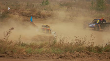wyscigi : Autocross on a dirt road by car buggy