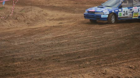 motorsports : Autocross on a dirt road in a sports car Stock Footage