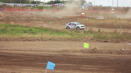 rali : Autocross on a dirt road in a sports car Stock Footage