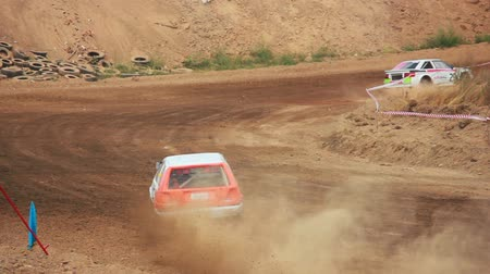 гоночный : Autocross on a dirt road in a sports car Стоковые видеозаписи
