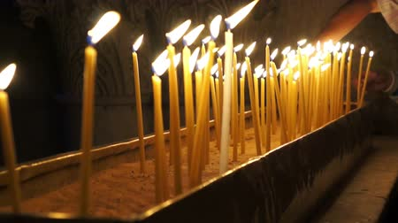 vallási : People light candles and put on a stand in the Temple of the Holy Sepulchre