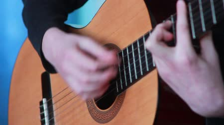 contentamento : human hand playing on the strings of the guitar Stock Footage