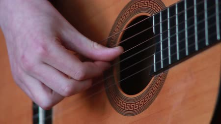 playing band : human hand playing on the strings of the guitar Stock Footage