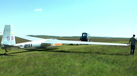 aerodrome : Pull glider aerodrome on the runway Stock Footage