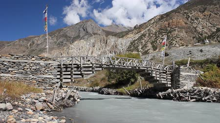flaga : HD video of a wooden bridge over a small river in Nepal
