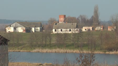 навес : Ruins of an old farm across the river in the background