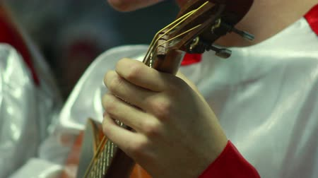 traditional instruments : human hand playing on the strings dombra Stock Footage