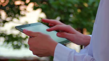 touchpad : Man Using Digital Tablet Computer  Outdoors In Nature