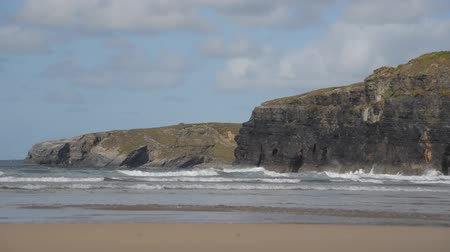 yolları : waves at Ballybunion beach and cliffs on the wild atlantic way in county Kerry Ireland Stok Video