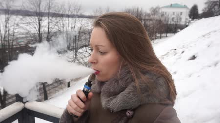 girl vaping outside
