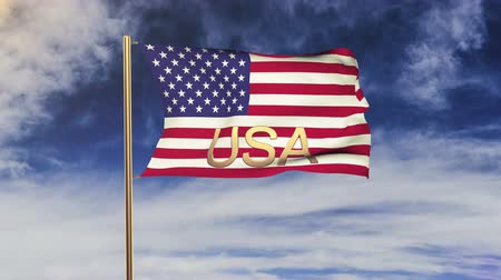 united states : United states flag with title USA waving in the wind. Looping sun rises style.