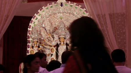 dussehra : DELHI, NEW DELHI, INDIA - 11 OCTOBER 2015: people is   roaming in pandal during navratri and celebrating   festival with goddegss durga. It is the biggest festival   of Hinduism and specially celebrating in kolkata Stock Footage