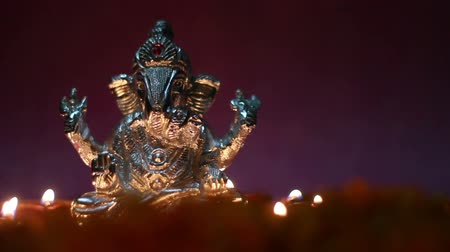 ganesha : lord ganesha with clay oil lamp and flowers, space for   text Stock Footage