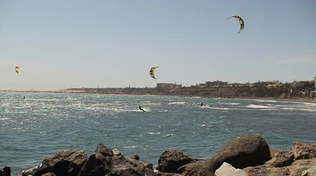 heyecan verici : Kitesurfers on the sea, slow motion