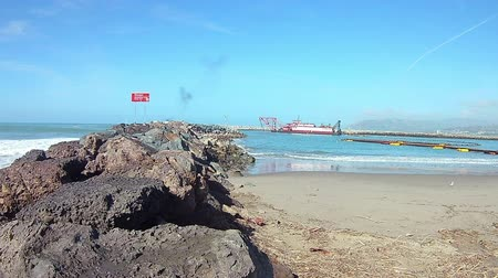 Time lapse dredge barge and support boats in Ventura Cove. Стоковые видеозаписи