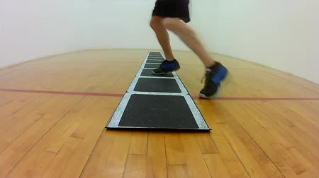 Athletic lateral movement left right in ladder footwork drill