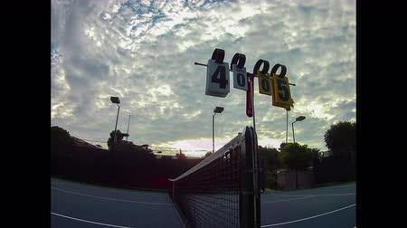 Tropical clouds wafting over the tennis courts.