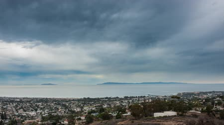 Time lapse of storm clouds moving in over coast town of Ventura.