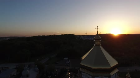 Aerial view of constructed church in Lviv, Ukraine. Aerial shot flying around golden shining dome.