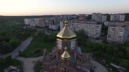 Aerial view of constructed church in Lviv, Ukraine. Aerial shot flying around the church.