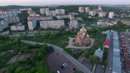 Aerial view of constructed church in Lviv, Ukraine. Aerial shot flying out-around church. Spring sunset.