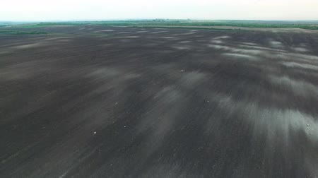 plough land : Texture of plowed field, 4k aerial view of plowed field prepared for planting. Flying forward along field. Stock Footage