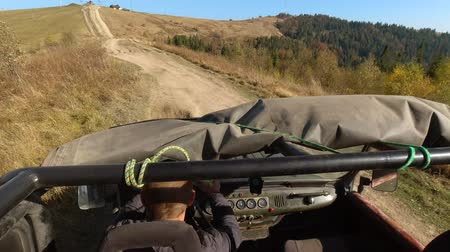 SUV going up a mountain. Off Road SUV. Passengers point of view. 4K Stock mozgókép