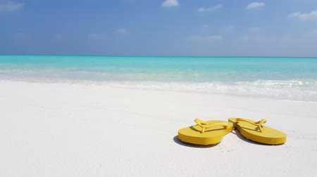 step : v02935 Maldives beautiful beach background white sandy tropical paradise island with blue sky sea water ocean 4k yellow flip flops Stock Footage