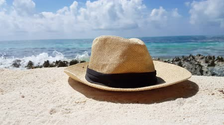 saman : Maldives beautiful beach background white sandy tropical paradise island with blue sky sea water ocean 4k beige trilby hat Stok Video