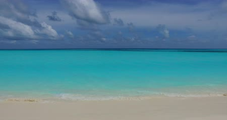 Мальдивы : v00694 Maldives beautiful beach background white sandy tropical paradise island with blue sky sea water ocean 4k