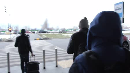 walkthrough : Airport to taxi walkthrough, people carrying bags. Airplane taxi. Stock Footage