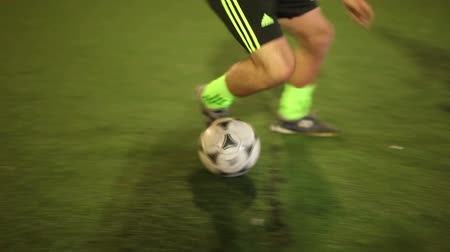 penas : Youth playing soccer. Football player tricks, gets a tackle, team breaks rules
