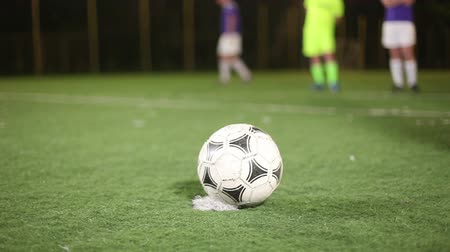 trest : Ball placed on a penalty spot, football (soccer) player strikes on goal