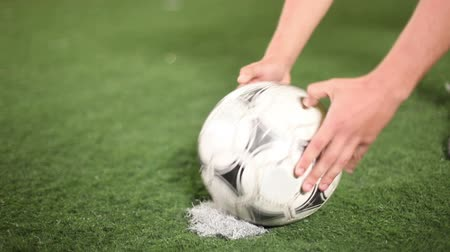 penas : Forward places a soccer-ball to a penalty spot for a kick. Soccer ball close up